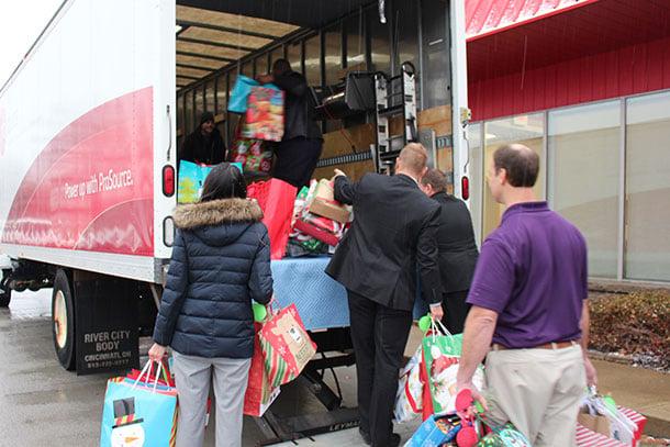 Prosource-Team-Members-loading-up-a-truck-full-of-Christmas.jpg