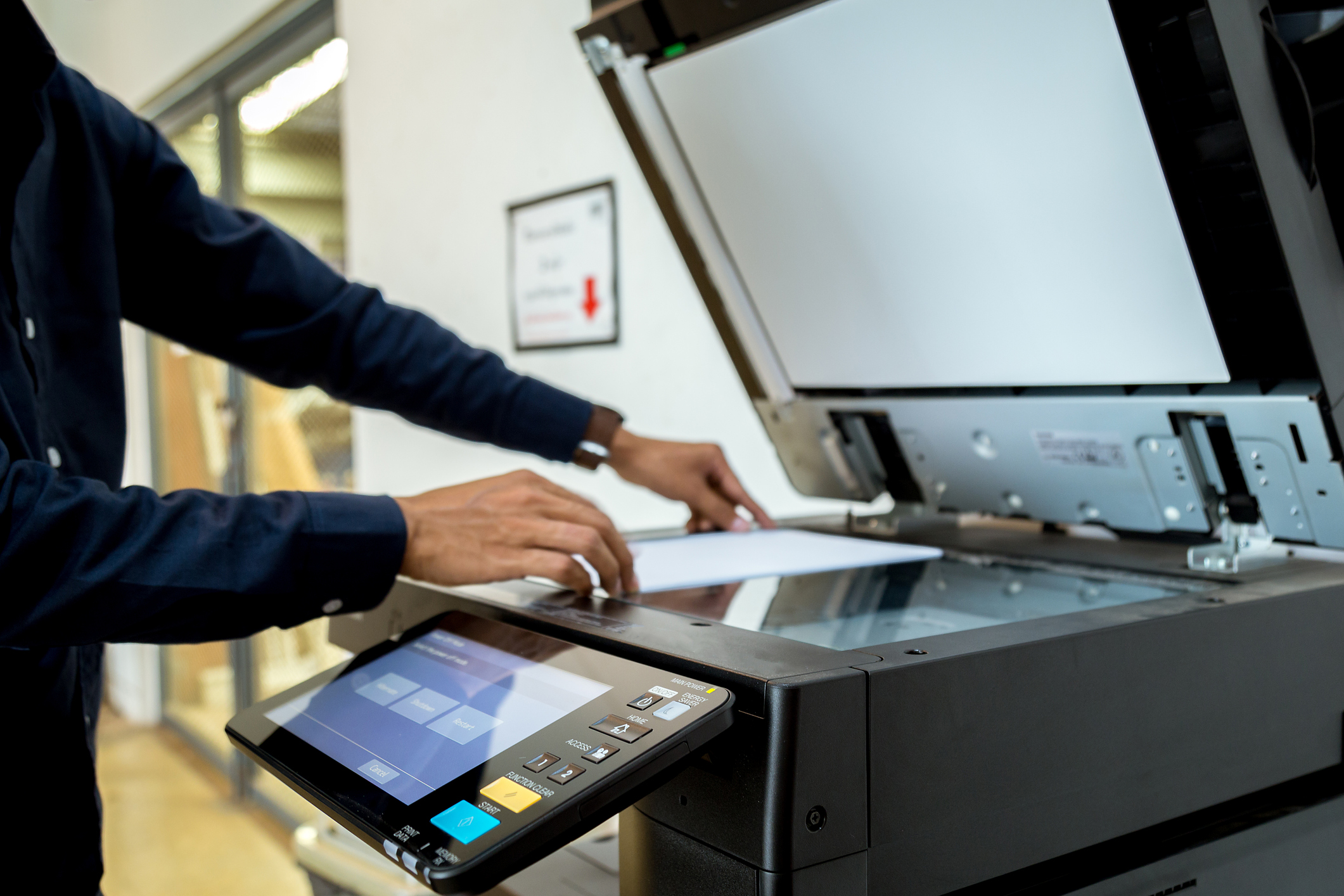 Businessman using multifunction printer (MFP)